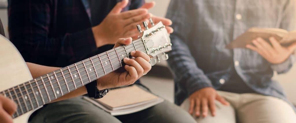 Young Men Playing Worship on Guitar