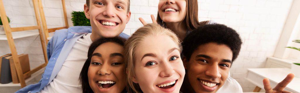 Teenagers together smiling for selfie together